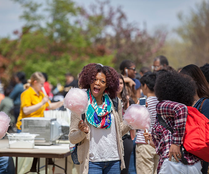 Student holding cotton candy
