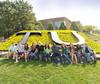Students sitting in front of large TU letters